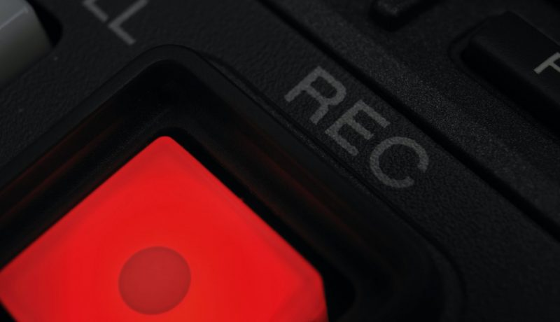 """Macro shot of the """"Record"""" button"""