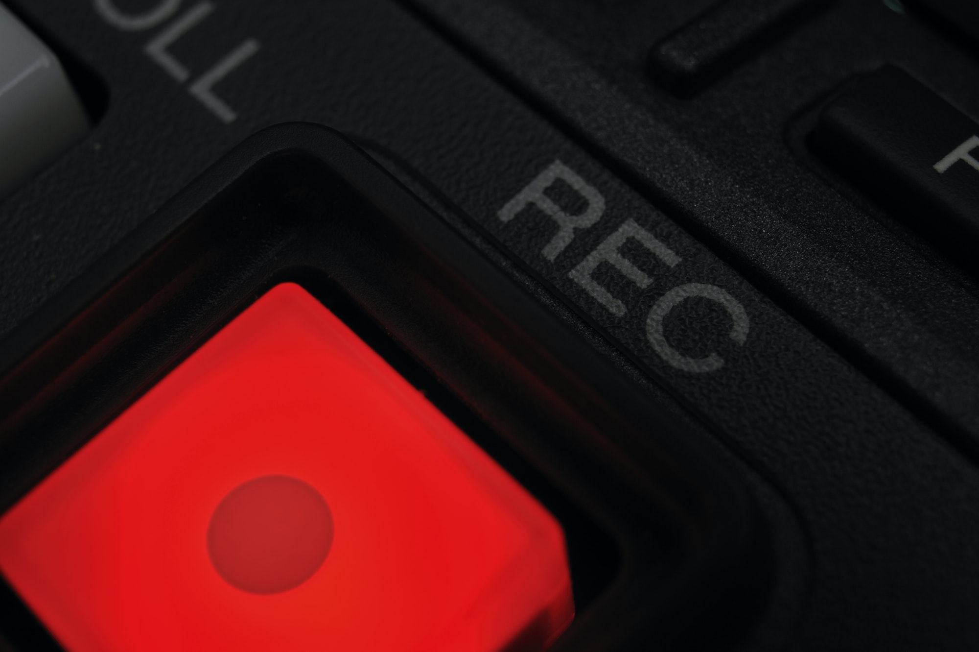 "Macro shot of the ""Record"" button"